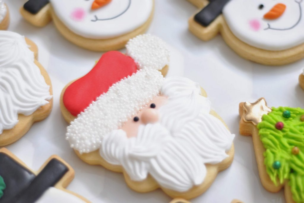 Image of cookies in the shape of snowmen and Santa Clause